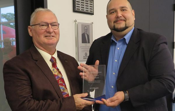 Dan Allison visits Q'STRAINT to bring Home the First Q'MANITARIAN Award